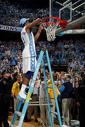 CHAPEL HILL, NC - MARCH 05: Dexter Strickland #1 of the North Carolina Tar Heels cuts down the net after defeating the Duke Blue Devils and winning the regular season ACC championship on March 05, 2011 at the Dean E. Smith Center in Chapel Hill, North Carolina. North Carolina won 67-81. (Photo by Peyton Williams/UNC/Getty Images) *** Local Caption *** Dexter Strickland