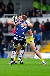 Bristol Rugby Number 8 (#8) Mitch Eadie tussles for the ball with Leeds Carnegie Outside Centre (#13) Peter Lucock - Photo mandatory by-line: Dougie Allward/JMP - Tel: Mobile: 07966 386802 13/10/2013 - SPORT - FOOTBALL - RUGBY UNION - Memorial Stadium - Bristol - Bristol Rugby v Leeds Carnegie - B&I Cup