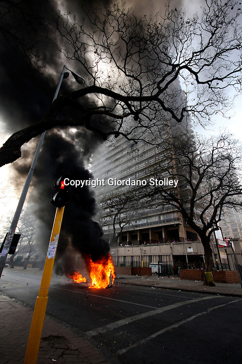 PRETORIA - 21 September 2011 - Police attempt to extinguish a burning portable toilet that Schubart Park residents set alight in protest at the lack of water..Picture: Giordano Stolley/Allied Picture Press/APP