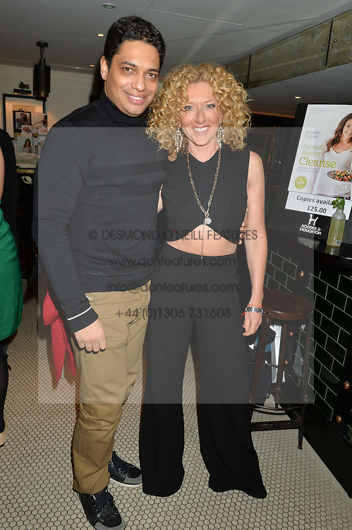 KELLY HOPPEN and PIERS LINNEY at a party to celebrate the publication of Honestly Healthy Cleanse by Natasha Corrett held at Tredwell's Restaurant, 4a Upper St.Martin's Lane, London on 14th January 2015.