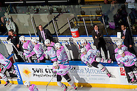KELOWNA, CANADA - OCTOBER 14: Scott Hoyer, athletic therapist, Kris Mallette, assistant coach, Brad Ralph, head coach and Travis Crickard assistant coach stand on the bench against the Red Deer Rebels on October 14, 2015 at Prospera Place in Kelowna, British Columbia, Canada.  (Photo by Marissa Baecker/Shoot the Breeze)  *** Local Caption *** Scott Hoyer; Kris Mallette; Brad Ralph; Travis Crickard;