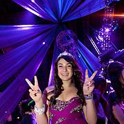 Bat Mitzvah girl under blue party ceiling