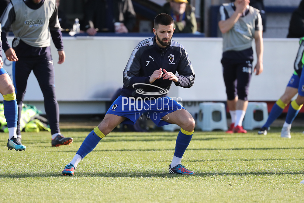 AFC Wimbledon defender George Francomb (7) warming up during the EFL Sky Bet League 1 match between AFC Wimbledon and Bristol Rovers at the Cherry Red Records Stadium, Kingston, England on 17 February 2018. Picture by Matthew Redman.