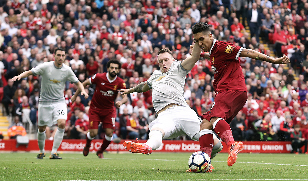 Liverpool's Roberto Firmino has his shot from close range  charged down by Manchester United's Phil Jones<br /> <br /> Photographer Rich Linley/CameraSport<br /> <br /> The Premier League - Liverpool v Manchester United - Saturday 14th October 2017 - Anfield - Liverpool<br /> <br /> World Copyright © 2017 CameraSport. All rights reserved. 43 Linden Ave. Countesthorpe. Leicester. England. LE8 5PG - Tel: +44 (0) 116 277 4147 - admin@camerasport.com - www.camerasport.com