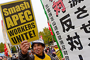 """A man holds a sign reading """"Smash Apec"""" at an anti APEC (Asia Pacific Economic Conference)  Demo by left-wing activist groups and trade unions in Yokohama, Japan Sunday, November 14th 2010"""