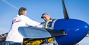 Crewman working on a Roll Royce P-51 engine, in the pits at the 2012 Reno Air Races.