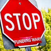 A stop sign turned into a protest sign against the funding of war.