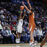 UNCASVILLE, CONNECTICUT- DECEMBER 4: Crystal Dangerfield #5 of the Connecticut Huskies shoots for three defended by Kelsey Lang #40 of the Texas Longhorns during the UConn Huskies Vs Texas Longhorns, NCAA Women's Basketball game in the Jimmy V Classic on December 4th, 2016 at the Mohegan Sun Arena, Uncasville, Connecticut. (Photo by Tim Clayton/Corbis via Getty Images)