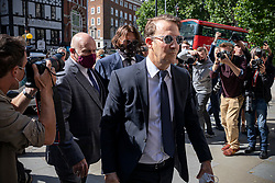 © Licensed to London News Pictures. 06/07/2020. London, UK. US actor Johhny Depp(centre, wearing face mask and sunglasses) arrives at The Hight Court in Central London. Johnny Depp's libel trial against The Sun newspaper is due to take place over the next three weeks over allegations he was violent and abusive towards his ex-wife Amber Heard. Photo credit: Rob Pinney/LNP
