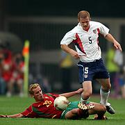 USA's John O;Brien tackled by Portugal's Beto