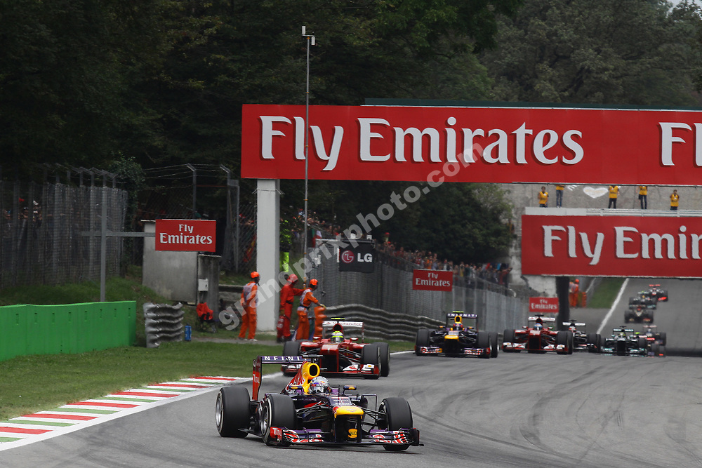 Sebastian Vettel (Red Bull-Renault) leads the field on the opening lap of the 2013 Italian Grand Prix in Monza. Photo: Grand Prix Photo