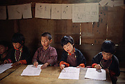 Bhutanese language writing class at the school in Gaselo, Bhutan. The school is an hour's walk from Shingkhey Village. Nalim and Namgay's daughter Bangam attends this school. From Peter Menzel's Material World Project.