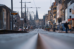 Edinburgh, Scotland, UK. 28 December 2020. Scenes from Edinburgh City Centre as Scotland starts first weekday under the most severe level 4 lockdown with all non-essential businesses closed. Pic; Princes Street traffic is quieter than normal.  Iain Masterton/Alamy Live News