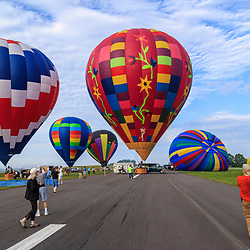 Avondale, PA, USA - June 24, 2018: Hot air balloons ready for flight at the Chester County Balloon Festival at the New Garden Flying Field in Toughkenamon PA.