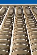 The balconies (lanais) of a tall hotel in Waikiki.