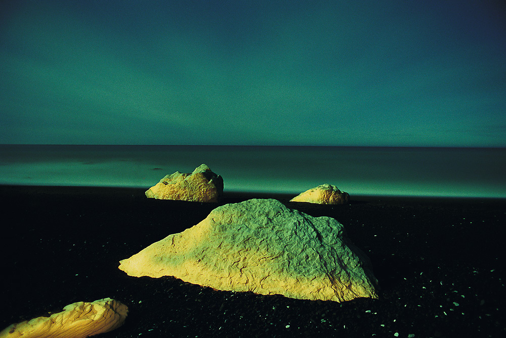 """Nape Nape.<br /> 2001.<br /> 320x490mm.<br /> C Type Print.<br /> Edition of Five. <br /> First shown in the exhibition """"Nightscapes"""" in the Dobson Bashford Gallery, Christchurch (2001).<br /> """".... resembles rocks or alien life forms on a lunar plain. His use of surreal colours further isolates the subjects from the everyday."""" John Stringer - Portals - March 2002."""