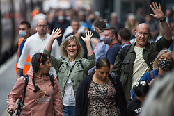 © Licensed to London News Pictures.  20/08/2021. London, UK. Passengers arrive at King's Cross Station in central London. Rail fares in England and Wales may rise by 4.8% in January, that would be the steepest increase since 2021. The government has not yet decided when the increases will come into force. Photo credit: Marcin Nowak/LNP