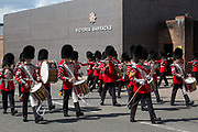 The 1st Battalion Grenadier Guards, led by the Grenadier Guards Corps of Drums, leaves Victoria Barracks to march to Windsor Castle to perform the Changing of the Guard ceremony on 29th July 2021 in Windsor, United Kingdom. The ceremony, which is also known as Guard Mounting, was reinstated on 22nd July for the first time since the beginning of the Covid-19 pandemic in March 2020.