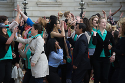 © London News Pictures. 23/06/15. London, UK. An attempt to break the Guinness world record for the most people performing a jumping high-five simultaneously is performed on Horse Guards Parade, Central London as part of National Women in Engineering Day. Photo credit: Laura Lean/LNP
