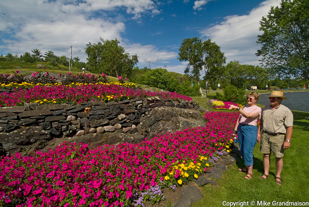 Gardens and tourists in McLeod Park<br />Kenora<br />Ontario<br />Canada