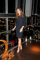CINDY CRAWFORD at the OMEGA VIP dinner hosted by Cindy Crawford and OMEGA President Mr. Stephen Urquhart held at aqua shard', Level 31, The Shard, 31 St Thomas Street, London, SE1 9RY on 10th December 2014.