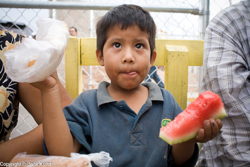16 JULY 2007 -- NOGALES, SONORA, MEXICO: MANUEL PATRON, 4, eats his first food in three days at the No More Deaths aid station near the Mexican port of entry in Nogales, Sonora, Mexico. Patron and his mother and sister were apprehended by the US Border Patrol Sunday night after they entered the US illegally Saturday. They wandered through the desert Saturday and Sunday. They were trying to get to Indiana. No More Deaths and the Sonora state government set up the aid station in 2006 to help Mexican immigrants deported from the US from across the US Border Patrol station in Nogales, Arizona. Volunteers at the aid station provide immigrants, many of whom spend days in the desert before being apprehended by the US Border Patrol, with food and water and rudimentary first aid. The immigrants then go back to their homes in Mexico or into Nogales to make another effort at crossing the border. Volunteers said they help between 600 and 1,000 immigrants per day. The program costs about .60¢ per person to operate. So far this year they've helped more than 130,000 people.  Photo by Jack Kurtz
