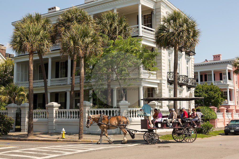Horse carriage passing the Louis DeSaussure House on East Battery in historic Charleston, SC.