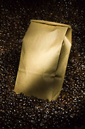 one pound bag of coffee and coffee beans still life
