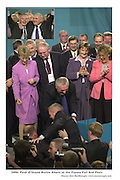 Taoiseach bertie Ahern pulls Paidi O'Seonto the stage at  the Fianna fail Ard Fheis in the Gleneagle Hotel, Killarney on Saturday..Picture by Don MacMonagle