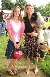 MISS CRESSIDA BONAS and her mother LADY MARY-GAYE CURZON with their dog  Weeming Cur at the Macmillan Cancer Relief Dog Day held at the Royal Hospital Chelsea South Grounds, London on 8th July 2003.