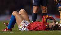 Photo: Paul Greenwood.<br />England v Spain. International Friendly. 07/02/2007. Spain's Carlos Puyol lies on the ground injured after tackling Shaun Wright Phillips