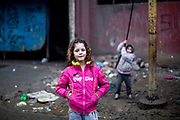 Ten years old Anna Maria who is living in LUNIK IX in front of one of the highrise buildings. LUNIK IX is populated with almost 100% Roma inhabitans and in the western-central part of the city of Kosice located in Eastern Slovakia.