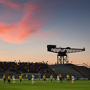 Morton v Partick Thistle. Scottish League Cup. Round Two. The sun sets during the match.Picture Robert Perry for The Evening Times 26th Aug 2014<br /> <br /> Must credit photo to Robert Perry<br /> FEE PAYABLE FOR REPRO USE<br /> FEE PAYABLE FOR ALL INTERNET USE<br /> www.robertperry.co.uk<br /> NB -This image is not to be distributed without the prior consent of the copyright holder.<br /> in using this image you agree to abide by terms and conditions as stated in this caption.<br /> All monies payable to Robert Perry<br /> <br /> (PLEASE DO NOT REMOVE THIS CAPTION)<br /> This image is intended for Editorial use (e.g. news). Any commercial or promotional use requires additional clearance. <br /> Copyright 2014 All rights protected.<br /> first use only<br /> contact details<br /> Robert Perry     <br /> 07702 631 477<br /> robertperryphotos@gmail.com<br /> no internet usage without prior consent.         <br /> Robert Perry reserves the right to pursue unauthorised use of this image . If you violate my intellectual property you may be liable for  damages, loss of income, and profits you derive from the use of this image.