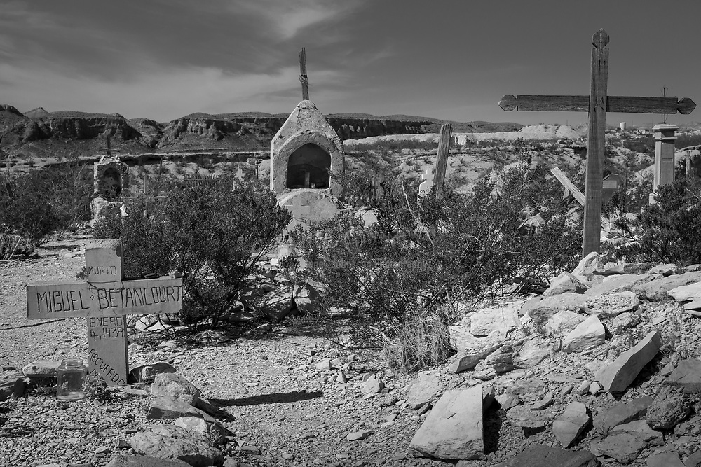 The small cemetery located along the downhill slope of the Terlingua Ghost Town, a formerly abandoned quicksilver mining camp turned tourist destination and residential community for desert dwellers, may be one of the most photographed cemeteries in Texas. No larger-than-life marble angels grace the gravesites here. Instead, modest filigree crosses, simple stonework, and small grottoes with hand-made embellishments highlight this historic burial spot, final resting place for miners who succumbed while digging for the highly toxic rare earth element known as mercury. This tiny site, just over one acre, contains marked graves beginning in 1903, the year mercury mining production in this region began. Unsurprisingly, fatal mining accidents occurred with some regularity, particularly in light of the inadequate ventilation and lack of modern mining equipment.