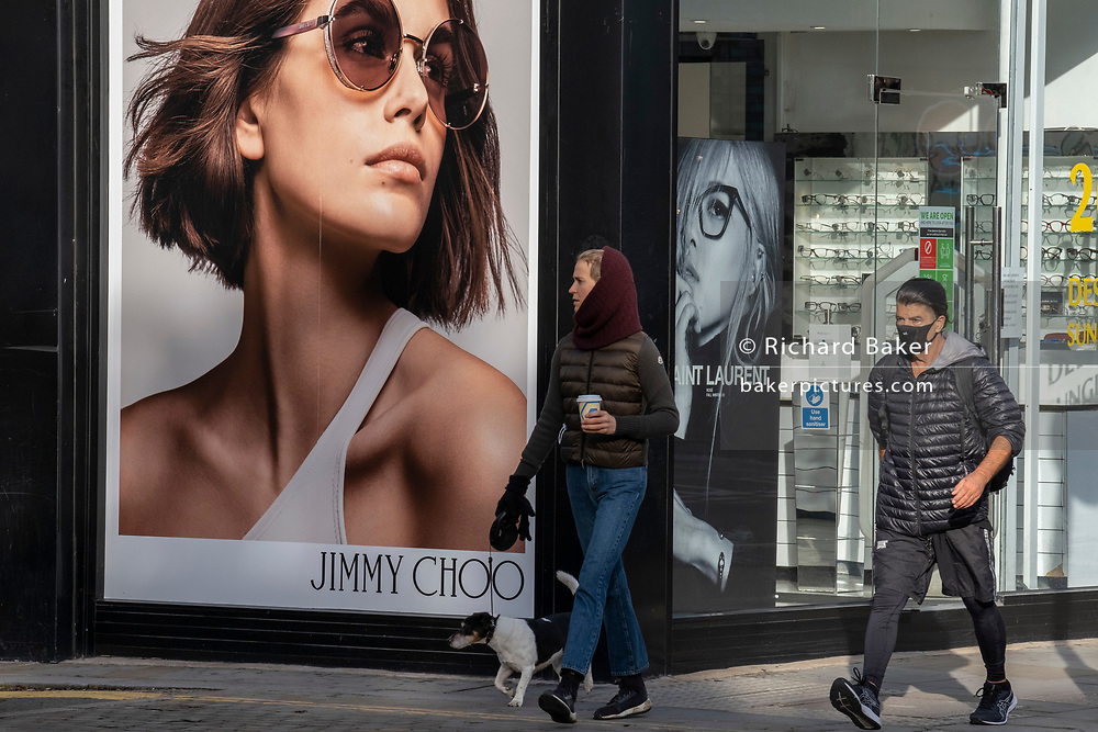 Shoppers on the King's Road in Chelsea walk past closed businesses during the second lockdown of the UK's Coronavirus pandemic, when all but essential retailers and businesses remain shut according to the government's restriction rules, on 13th November 2020, in London, England.