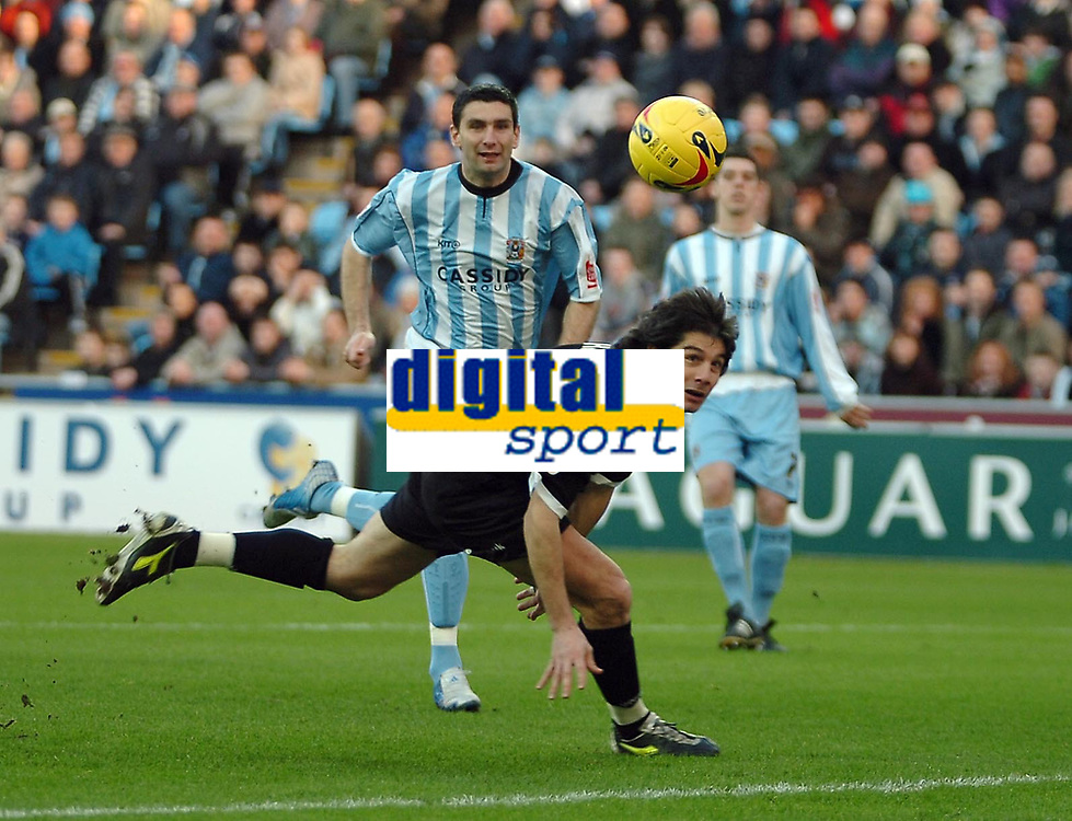 Photo: Ed Godden.<br />Coventry City v Derby County. Coca Cola Championship. 21/01/2006. <br />Paul Peschisolido (R) makes his way past Coventry's Ady Williams to make it 1-0 for Derby.