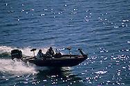 Bass fishing boat speeds across Clear Lake, near Lucerne, Lake County, California