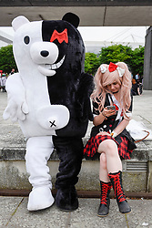 © Licensed to London News Pictures. 28/05/2017. London, UK.  (L to R) Mono Kuma and Junko from Damganronpa at MCM Comic Con taking place at Excel in East London.  The three day event celebrates popular comic books, anime, games, television and movies.  Many attendees take the opportunity to dress as their favourite characters.    Photo credit : Stephen Chung/LNP