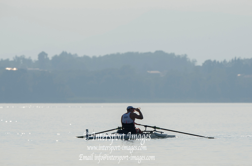 Varese. ITALY.   GBR ASM1X Tom AGGAR  rehydrates, while warming up for his heat at the  2015 FISA World Cup II Venue Lake Varese. Thursday  18/06/2015 [Mandatory Credit: Peter Spurrier/Intersport images]
