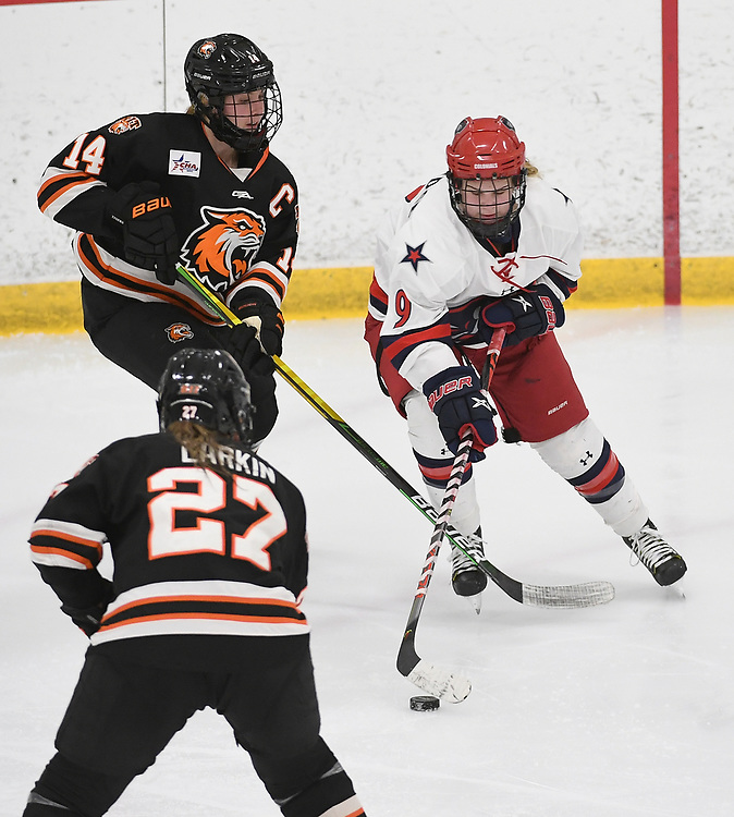PITTSBURGH, PA - JANUARY 29: Maggy Burbidge #9 of the Robert Morris Colonials skates with the puck as Ellie Larson #14 of the RIT Tigers defends in the third period during the game at Clearview Arena on January 29, 2021 in Pittsburgh, Pennsylvania. (Photo by Justin Berl/Robert Morris Athletics)