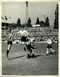 Jun. 27, 1954 - 27-6-54 Uruguay beat England in World Cup Match – England were beaten by four goals to two in the World Cup match against Uruguay yesterday at Basle. Keystone Photo Shows: Lofthouse leaps for the ball, watched by Tom Finney (right), during the match at Basle yesterday. (Credit Image: © Keystone Press Agency/Keystone USA via ZUMAPRESS.com)