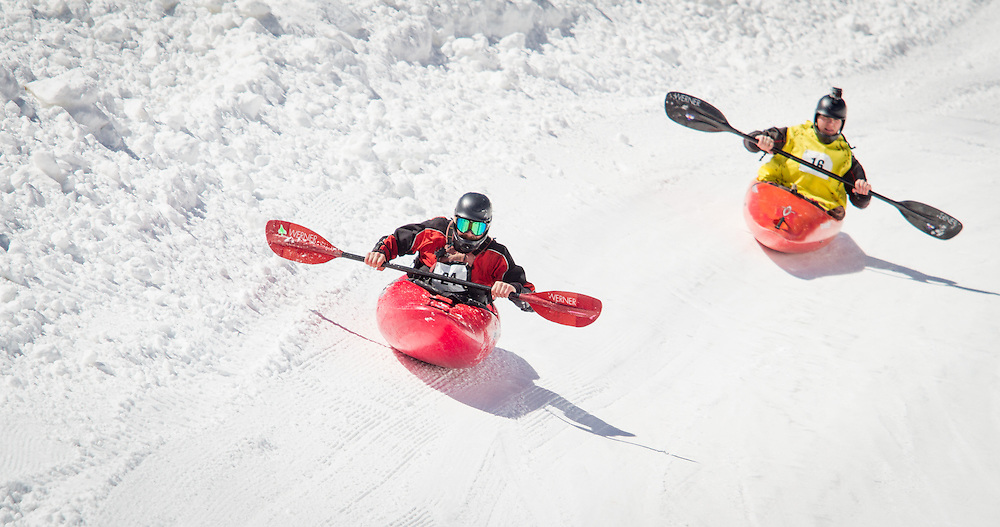 Josh Stupka leads his heat, toward his eventual win over other competitors racing down a flume built of snow in the annual Kayaks on the Snow event at Monarch Mountain. Photo ©2014 Greg Smith