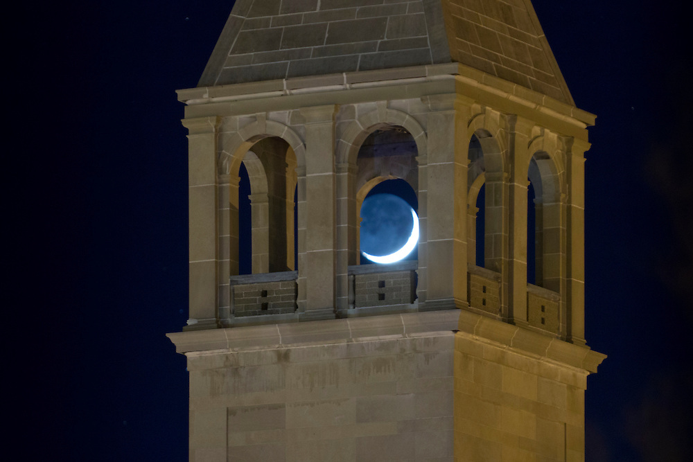 Middletown, New York - The crescent moon shines through the steeple of the former Our Lady of Mount Carmel Church on Nov. 24, 2014. The building is now the Mulberry House Senior Center.