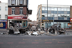 © Licensed to London News Pictures. 07/08/2011. Tottenham, UK. The shell of a burned out bus. Mass rioting and vandalism broke out along Tottenham High Street and many building were set alight. Photo credit : Joel Goodman/LNP
