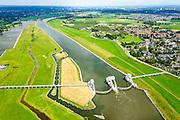 Nederland, Gelderland, Gemeente  Overbetuwe, 26-06-2013; stuwcomplex bij Driel in de Neder-rijn. De stuw reguleert waterniveau in de Neder-rijn en de IJssel. Bijgenaamd De Kraan van Nederland. Naast de stuw een schutsluis en vispassage.<br /> Barrage or flood gate in Lower Rhine, regulates waterlevel, west of Arnhem.<br /> luchtfoto (toeslag op standaard tarieven);<br /> aerial photo (additional fee required);<br /> copyright foto/photo Siebe Swart.