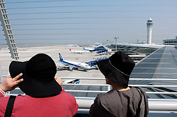 Women looking at aircraft from modern Skydeck at Nagoya International Airport Chubu in Japan