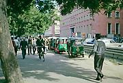 Street scene people, cyclist, motorised rickshaws in New Delhi, India 1964