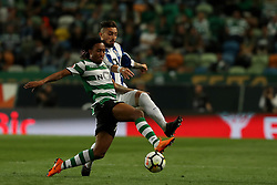 April 18, 2018 - Lisbon, Portugal - Sporting's forward Gelson Martins from Portugal (L) vies with Porto's Brazilian defender Alex Telles during the Portugal Cup semifinal second leg football match Sporting CP vs FC Porto at the Alvalade stadium in Lisbon on April 18, 2018. (Credit Image: © Pedro Fiuza via ZUMA Wire)