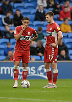 Middlesbrough's Marcus Tavernier and Paddy McNair prepare to take a free kick <br /> <br /> Photographer Ian Cook/CameraSport<br /> <br /> The EFL Sky Bet Championship - Cardiff City v Middlesbrough - Saturday 23rd October 2021 - Cardiff City Stadium - Cardiff<br /> <br /> World Copyright © 2020 CameraSport. All rights reserved. 43 Linden Ave. Countesthorpe. Leicester. England. LE8 5PG - Tel: +44 (0) 116 277 4147 - admin@camerasport.com - www.camerasport.com