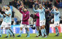 Manchester City's Nicolas Otamendi (left), Sergio Aguero and Danilo acknowledge fans after the final whistle during the Premier League match at St James' Park, Newcastle.